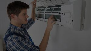 Technician Repairing Air Conditioner Parallax
